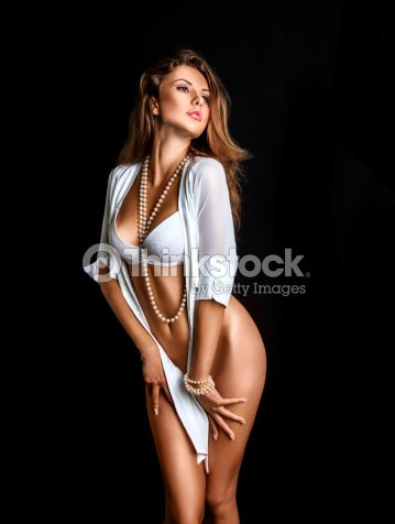 cac3c9cd6d9 Sexy Girl In Lingerie On Black Background Stock Photo - Thinkstock