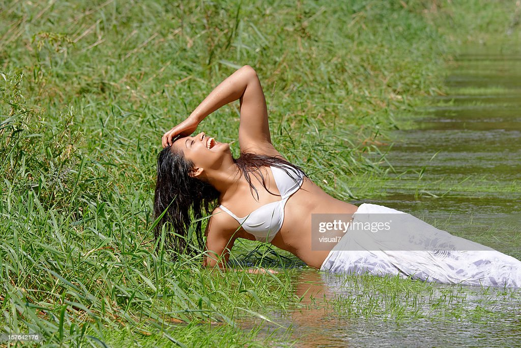 sexy indian woman laughing in the water