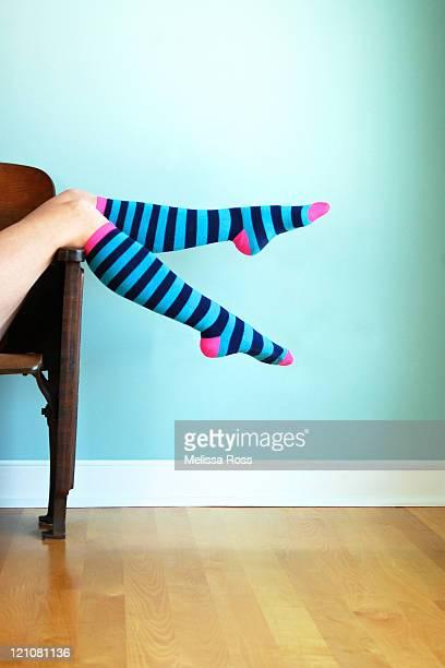Sexy legs in bluet sriped knee socks.