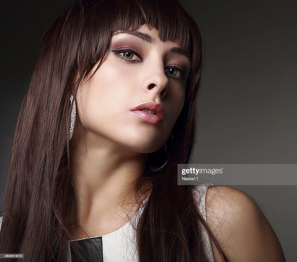 Sexy makeup girl with long hair. Closeup portrait : Stock Photo