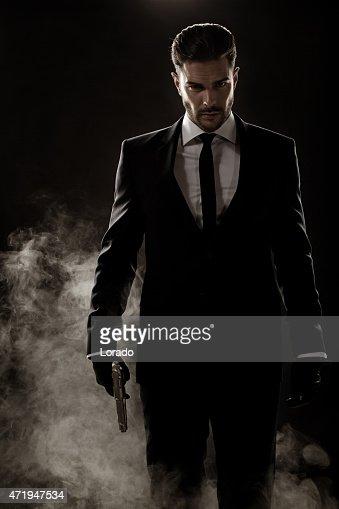 sexy man walking holding gun