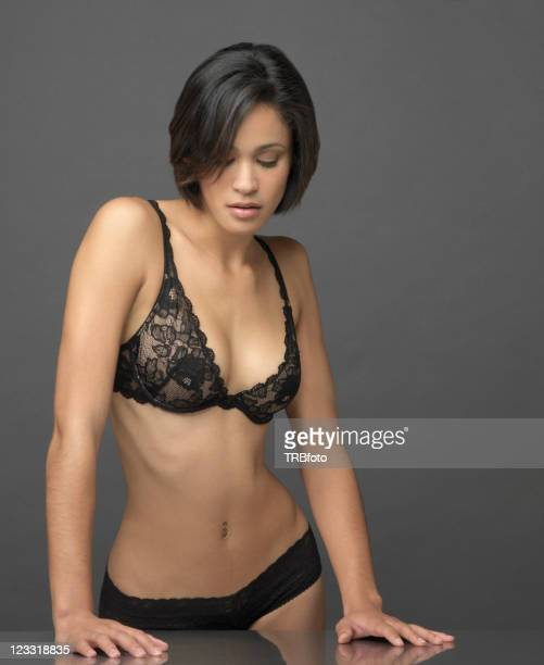 Sexy mixed race woman in lingerie