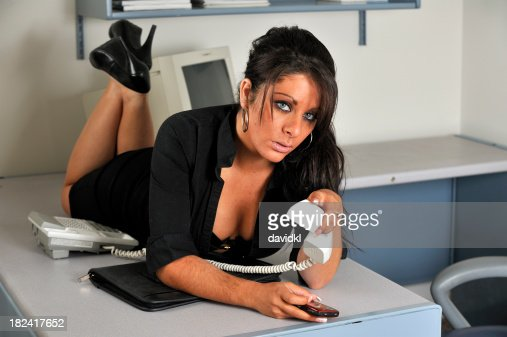 sexy secretary laying on desk stock photo getty images
