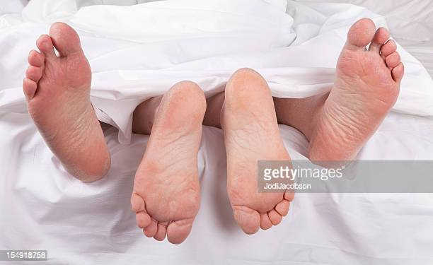 sexy senior feet in bed