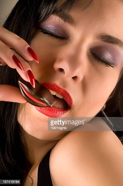 sexy woman holding chocolate