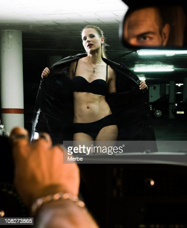 Sexy woman in front of a driver : Stock Photo