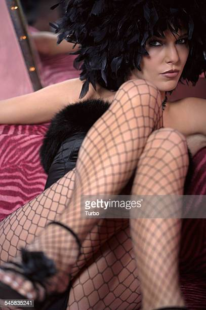 Sexy Woman in Wig and Fishnet Stockings