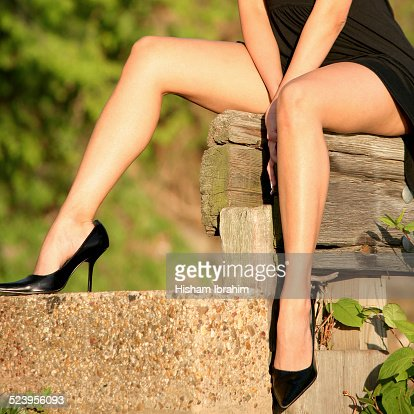 Sexy Woman Legs In High Heels And Mini Dress Stock Photo | Getty ...