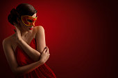 Sexy Woman Mask, Sensual Girl Carnival Masquerade, Beauty Fashion Model over Red background looking to side