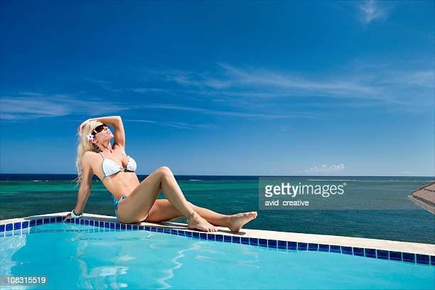 Sexy Woman Relaxing by Pool