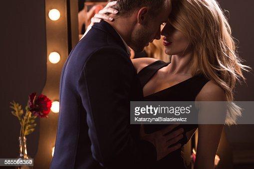 Sexy woman seducing a man : Stock Photo