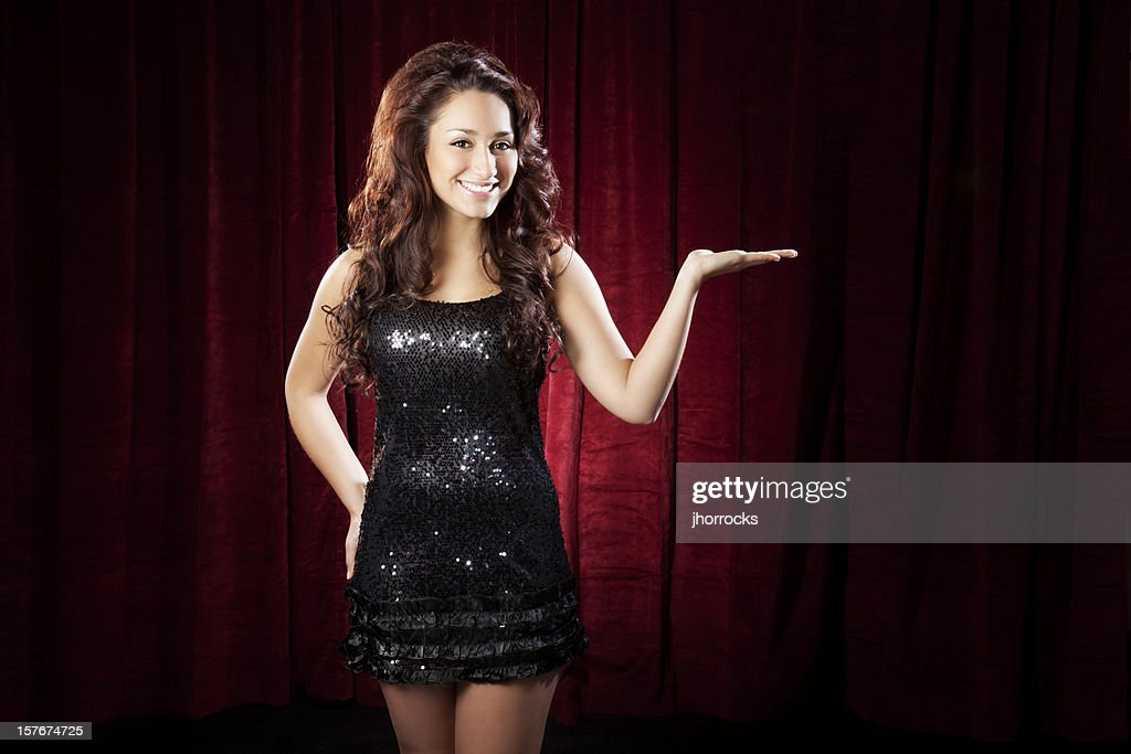 Sexy Young Hispanic Woman Presenting on Stage