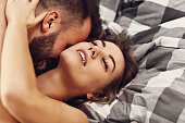 Picture showing sexy young lovers being intimate in bed