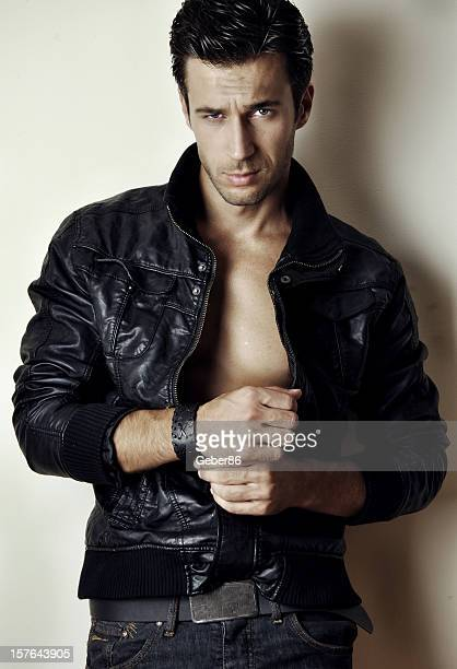 Young Man Posing With Leather Jacket Stock Photo | Getty Images