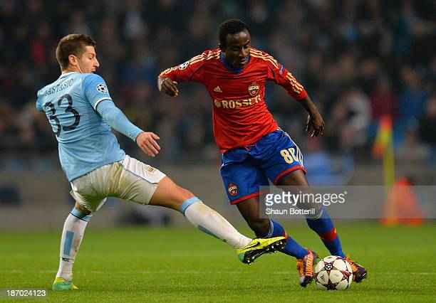 Seydou Doumbia of CSKA is challenged by Matija Nastasic of Manchester City during the UEFA Champions League Group D match between Manchester City and...