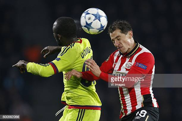 Seydou Doumbia of CSKA Moscow Andres Guardado of PSV during the UEFA Champions League match between PSV Eindhoven and CSKA Moscow on December 8 2015...