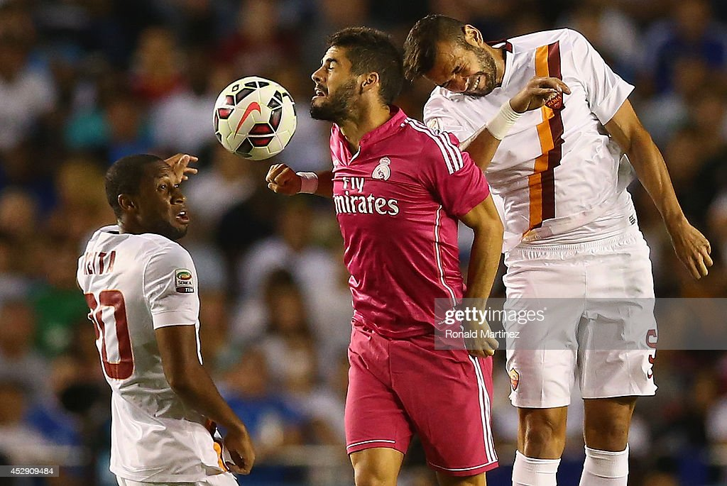 Seydou Keita #20, Isco #23 of Real Madrid and Leandro Castan of AS Roma during a Guinness International Champions Cup 2014 game at Cotton Bowl on July 29, 2014 in Dallas, Texas.