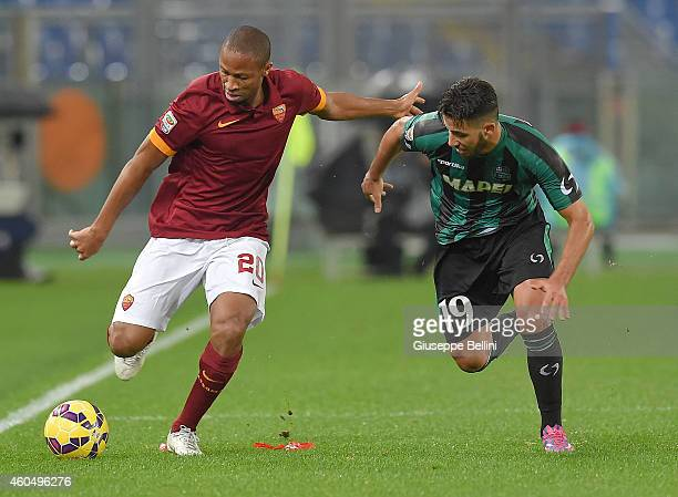 Seydou Keita of AS Roma and V of US Sassuolo in action during the Serie A match between AS Roma and US Sassuolo Calcio at Stadio Olimpico on December...
