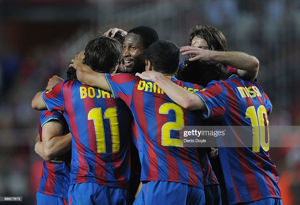 <a gi-track='captionPersonalityLinkClicked' href=/galleries/search?phrase=Seydou+Keita&family=editorial&specificpeople=709847 ng-click='$event.stopPropagation()'>Seydou Keita</a> of Barcelona players celebrates with teammates after Barcelona scored their 3rd goal during the La Liga match between Sevilla and Barcelona at Estadio Ramon Sanchez Pizjuan on May 8, 2010 in Seville, Spain.