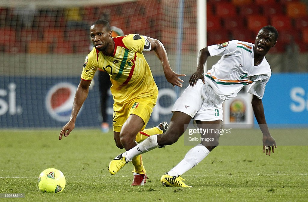 <a gi-track='captionPersonalityLinkClicked' href=/galleries/search?phrase=Seydou+Keita&family=editorial&specificpeople=709847 ng-click='$event.stopPropagation()'>Seydou Keita</a> of Mali in action against Karim Lancina of Niger during the 2013 African Cup of Nations match between Mali and Niger at Nelson Mandela Bay Stadium on January 20, 2013 in Port Elizabeth, South Africa.
