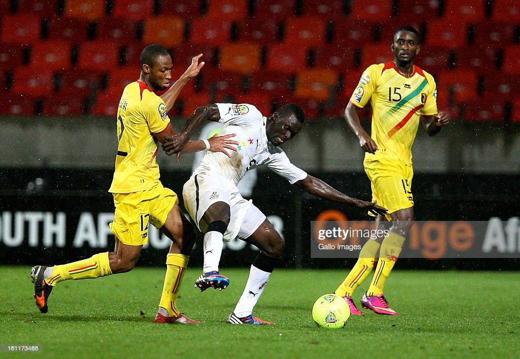AFRICA - FEBRUARY 09, Seydou Keita of Mali (L) Mohammed Awal of Ghana and Mahamadou Samassa of Mali (R) during the 2013 Orange African Cup of Nations 3rd and 4th Play-Off match between Mali and Ghana from Nelson Mandela Bay Stadium on February 09, 2013 in Port Elizabeth, South Africa.