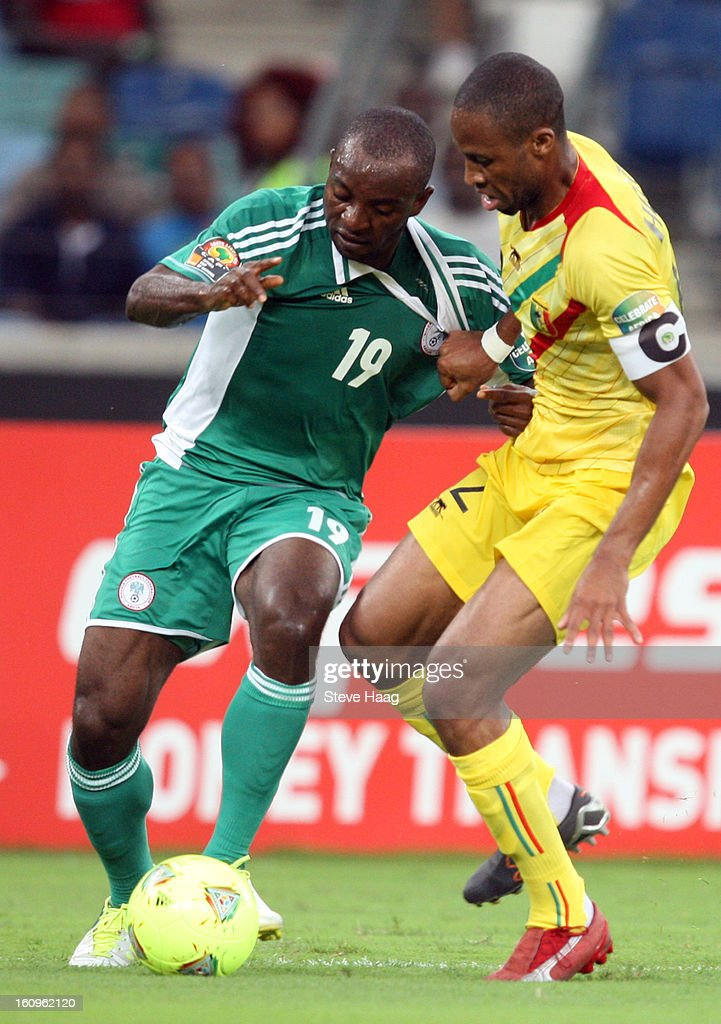 Seydou Keita of Mali pulling back Sunday Mba of Nigeria during the 2013 African Cup of Nations Semi-Final match between Mali and Nigeria at Moses Mahbida Stadium on February 06, 2013 in Durban, South Africa.