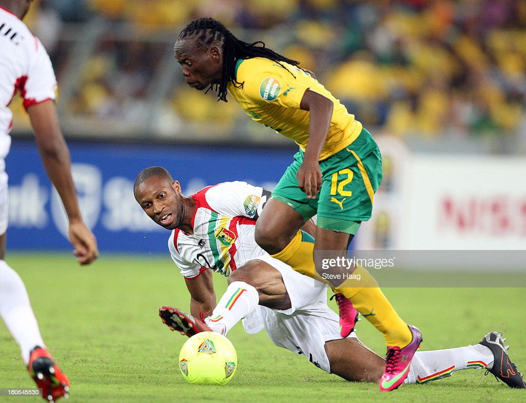 Seydou Keita of Mali tackles Reneilwe Letsholonyane of South Africa during the 2013 African Cup of Nations Quarter-Final match between South Africa and Mali at Moses Mahbida Stadium on February 02, 2013 in Durban, South Africa.