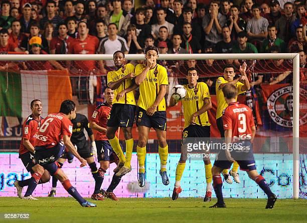 Seydou Keita Zlatan Ibrahimovic Sergio and Xavi Hernandez of Barcelona block a free kick by Javad Nekouman of Osasuna during the La Liga match...
