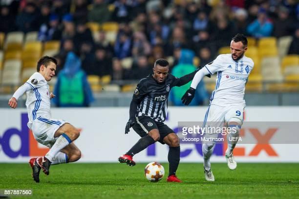Seydouba Soumah of FK Partizan Belgrade competes with Mykola Morozyuk of FC Dynamo Kyiv during the UEFA Europa League group B match between FC Dynamo...