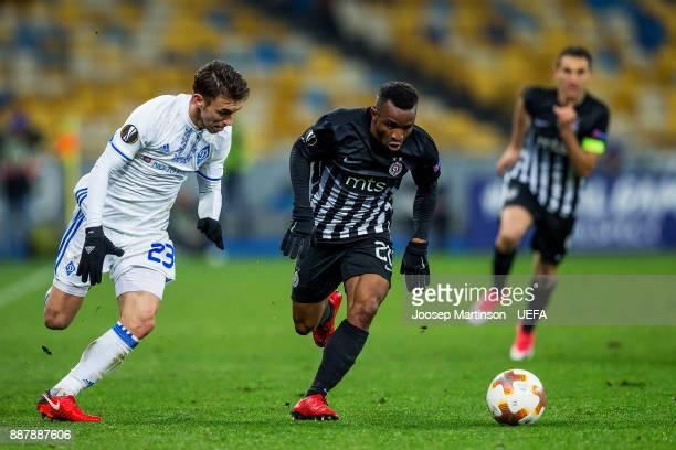 Seydouba Soumah of FK Partizan Belgrade gets away from Josip Pivaric of FC Dynamo Kyiv during the UEFA Europa League group B match between FC Dynamo...