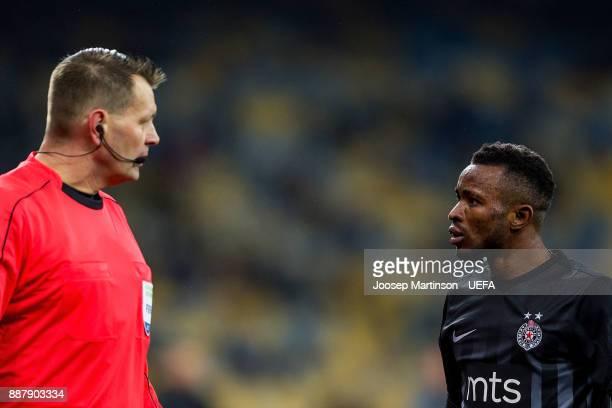 Seydouba Soumah of FK Partizan Belgrade has a word with the linesman during the UEFA Europa League group B match between FC Dynamo Kyiv and FK...