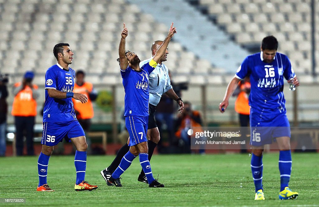 Seyed Iman Mousavi (L) and Farhad Majidi of Esteghlal celebrate during the AFC Champions League Group D match between Esteghlal and Al Rayyan at Azadi Stadium on April 23, 2013 in Tehran, Iran.