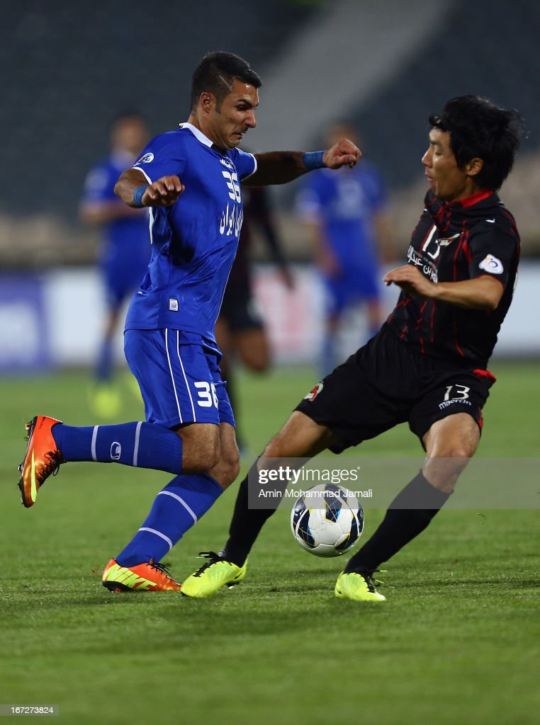 Seyed Iman Mousavi of Esteghlal and Cho yong Hyung during the AFC Champions League Group D match between Esteghlal and Al Rayyan at Azadi Stadium on April 23, 2013 in Tehran, Iran.
