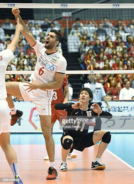 Seyed Mohammad Mousavi Eraghi celebrates Iran's block point against Yuki Ishikawa of Japan in the third set of a match in the Olympic men's...