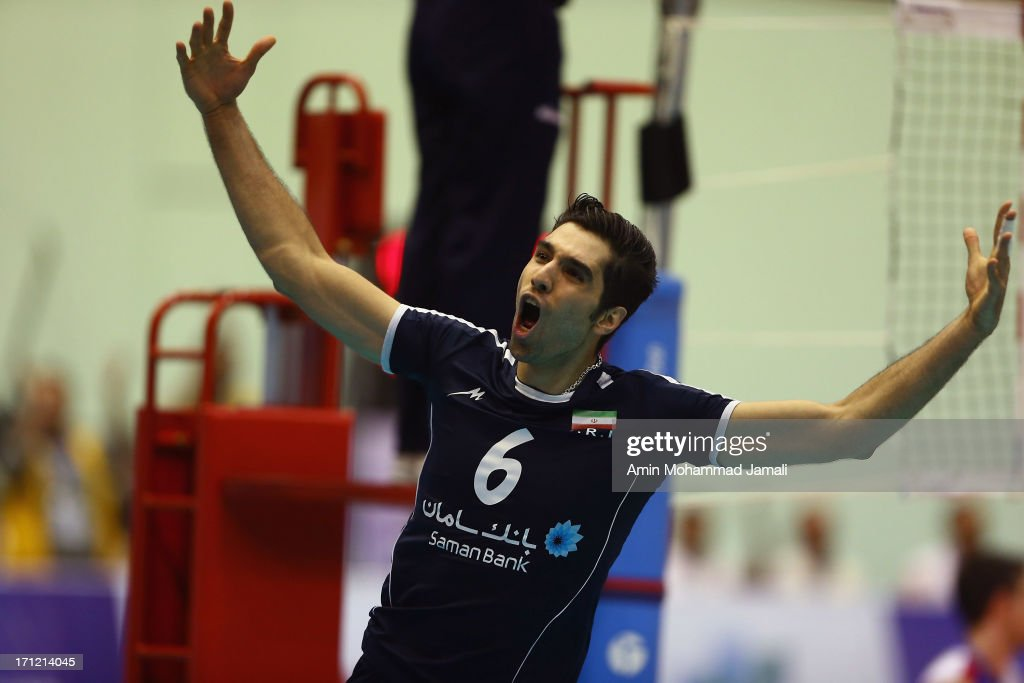 Seyed Mohammad Mousavi Eraghi of Iran celebrates during the Volleyball World League match between Iran and Serbia on June 23, 2013 in Tehran, Iran Azadi Complex.