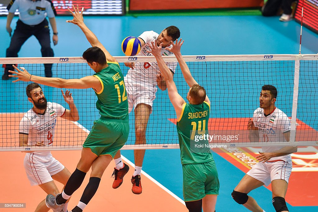 Seyed Mohammad Mousavi Eraghi #6 of Iran spikes the ball during the Men's World Olympic Qualification game between Iran and Australia at Tokyo Metropolitan Gymnasium on May 28, 2016 in Tokyo, Japan.