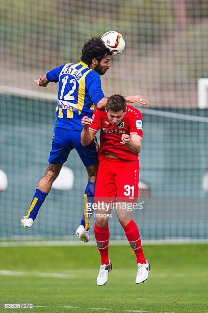 SeyedMehdi Salehi of Gostaresh Foolad FC and Waldemar Anton of Hannover 96 battle for the ball during the Friendly Match between Hannover 96 and...