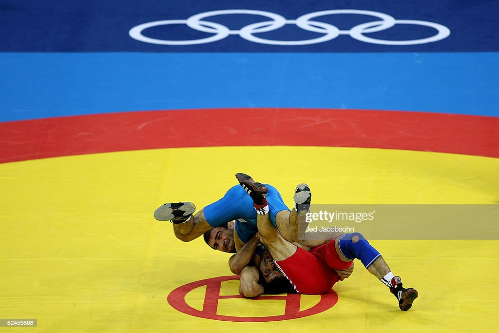Seyedmorad Mohammadi (Blue) of Iran and Zelimkhan Huseynov of Azerbaijan compete in the men's 60kg freestyle wrestling bronze medal match at the China Agriculture University Gymnasium on Day 11 of the Beijing 2008 Olympic Games on August 19, 2008 in Beijing, China.