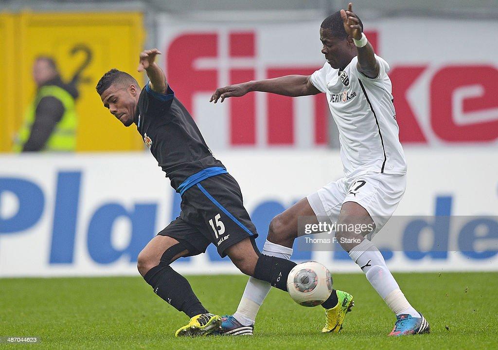 Seyi Olajengbesi (R) of Sandhausen tackles Elias Kachunga of Paderborn during the Second Bundesliga match between SC Paderborn and SV Sandhausen at Benteler Arena on April 27, 2014 in Paderborn, Germany.