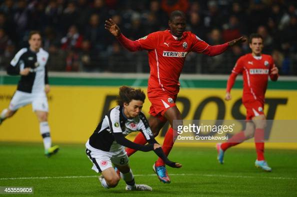 Seyi Olajengbesi of SV Sandhausen brings down Takashi Inui of Eintracht Frankfurt during the DFB Cup match between Eintracht Frankfurt and SV...