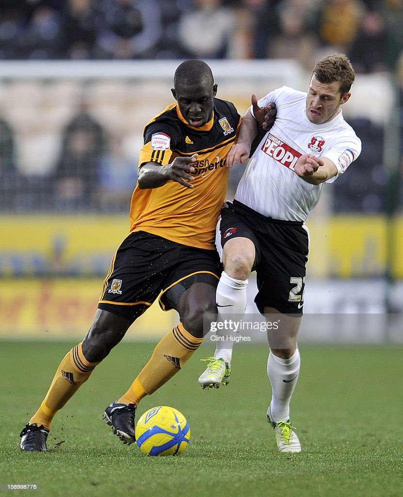 Seyi Olofinjana (Left) of Hull City tackles Martin Rowlands of Leyton Orient during the FA Cup with Budweiser Third Round match between Hull City and Leyton Orient at the KC Stadium on January 5, 2013 in Hull, England