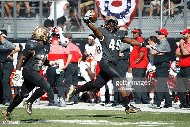 Seyvon Lowry of the Central Florida Knights reacts after recovering a fumble against the Cincinnati Bearcats in the fourth quarter of the game at...