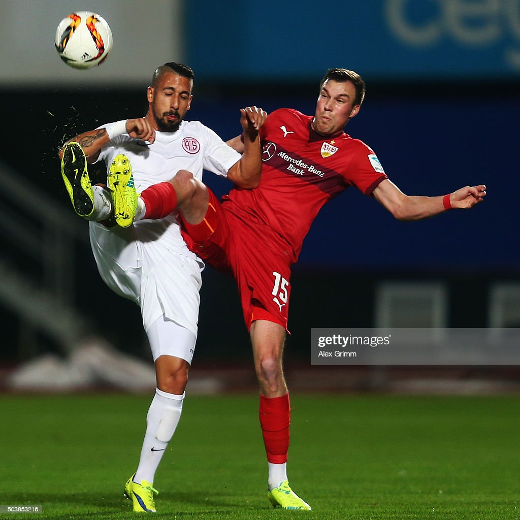 Sezer Badur (L) of Antalyaspor is challenged by Kevin Grosskreutz of Stuttgart during a friendly match between VfB Stuttgart and Antalyaspor at Akdeniz Universitesi on January 7, 2016 in Antalya, Turkey.