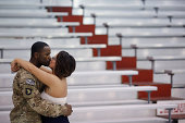 Sgt 1st Class Craig Cooper of the US Army's 159th Combat Aviation Brigade 101st Airborne Division kisses his girlfriend Ashley Zeigler following a...