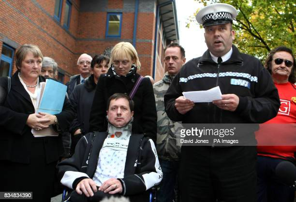 Sgt Andy Kavanagh reads a statement as Phil and Amanda Peak leave Stoke on Trent Crown Court after footballer Luke McCormick was jailed for seven...
