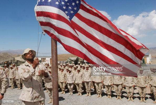 Sgt Brandon raises the US flag to halfmast at an afternoon ceremony September 11 2002 at Orgune forward base in Afghanistan The ceremony marked the...