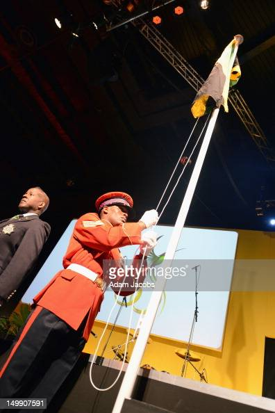 Sgt Clive McKenzie raises the Jamaican flag during the Jamaica 50 Flag Raising Ceremony at Jamaica House at O2 Arena on August 6 2012 in London...