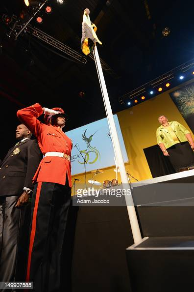 Sgt Clive McKenzie salutes the Jamaican flag during the Jamaica 50 Flag Raising Ceremony at Jamaica House at O2 Arena on August 6 2012 in London...