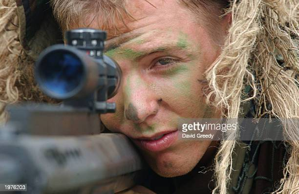 Sgt Corbin Robinson of Groveland MA looks through a 50 caliber SASR scope on May 6 during 'Balikatan 03' exercises at Ft Magsaysay in Nueva Ecija...
