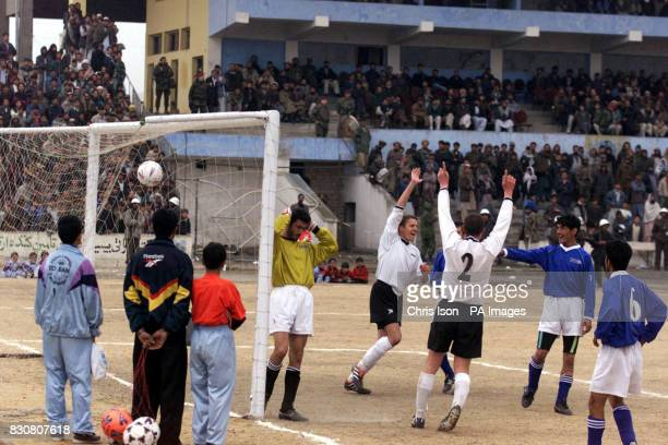 Sgt Darren Mortimer celebrates his goal during a soccer match at the Olympic Stadium in Kabul Afghanistan between ISAF and Kabul FC * The game was...